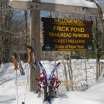 Frick trrailhead sign with snowshoes